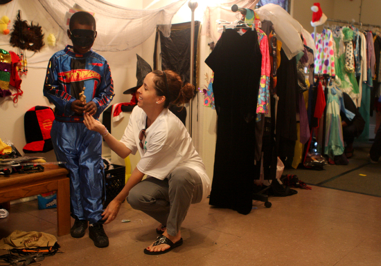 An 8-year-old boy tries on a new Hot Wheels costume at the Freret Neighborhood Center's annual Halloween festival in 2010. (UptownMessenger.com file photo by Sabree Hill)