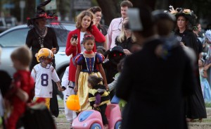 Children trick or treating at the corner of St. Charles and State St. Sunday evening.