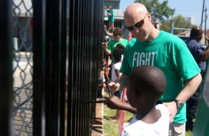 "At a ""Fight the Blight"" event in March 2011, Mayor Mitch Landrieu paints a gate around the pool at Taylor Park in Hoffman Triangle with Laquinn Huey, who was 8 at the time. NOLA For Life Day, a continuation of those efforts, will be held Saturday at A.L. Davis Park in Central City. (UptownMessenger.com file photo by Sabree Hill)"