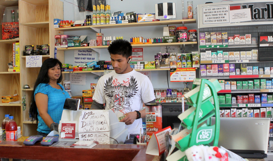 Alba Sanabria and Rolando Zelaya work at the Las Acacias corner store in March 2011. (Sabree Hill, UptownMessenger.com)