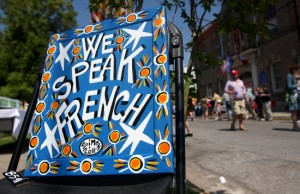 "The artwork of folk artist Simon Hardeveld reads ""We Speak French"" at Fete Francaise Saturday afternoon.  (Sabree Hill, UptownMessenger.com)"