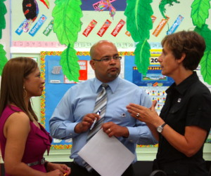 Principal Melanie Tennyson (right) speaks to other International School administrators in May of 2011. (UptownMessenger.com file photo by Robert Morris)