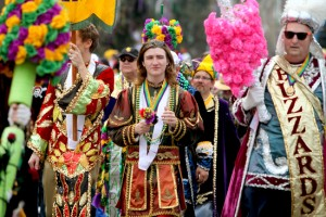 The Jefferson City Buzzards travel down St. Charles Avenue handing out flowers to crowds on Mardi Gras Day in 2012. (UptownMessenger.com file photo by Sabree Hill)