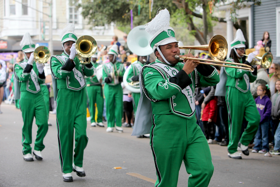 The Walter L. Cohen High School marching band performs during the Krewe of Mid-CIty parade in 2012. (UptownMessenger.com file photo by Sabree Hill)
