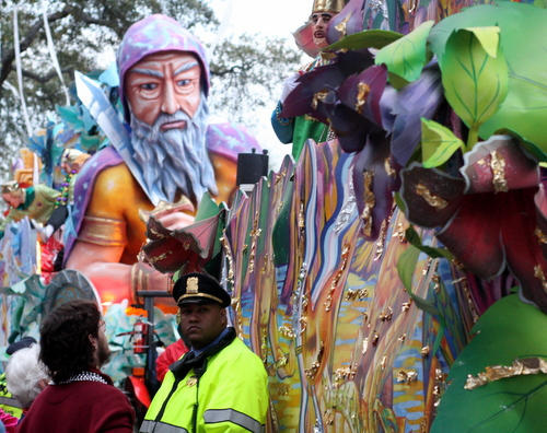 NOPD Sgt. Marc Amos watches the crowd during a pause in the Krewe of Proteus parade in 2012. A number of new laws govern parade-goers this year. (UptownMessenger.com file photo by Robert Morris)