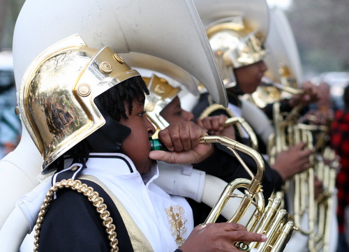 The Roots of Music brass band performs on Napoleon Avenue during the Krewe of Proteus parade in 2012. (Robert Morris, UptownMessenger.com)