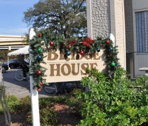 The Bridge House sign at Grace House, decked out for the holidays. (UptownMessenger.com file photo by Marta Jewson)