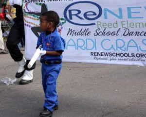A pint-sized soldier marches in front of the ReNEW Reed Elementary middle school dance team on Napoleon Avenue during Mardi Gras 2013. (UptownMessenger.com file photo by Robert Morris)