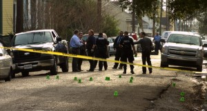 Police officers stand amid shell casings marking the scene of a fatal shooting on Chippewa Street in the Irish Channel on Feb. 21, 2013. (UptownMessenger.com file photo by Robert Morris)