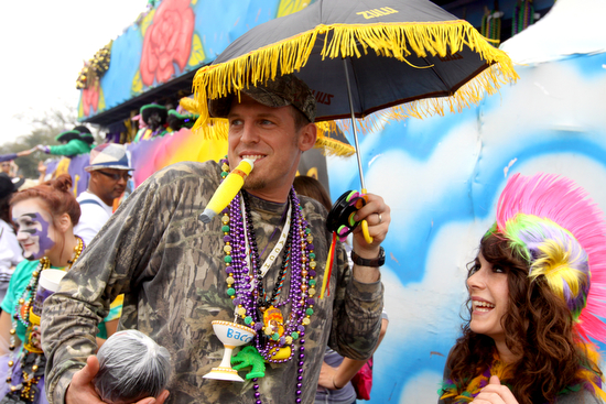 Fake cigars are a traditional throw during the Krewe of Zulu parade. (UptownMessenger.com file photo by Sabree Hill, Feb. 13, 2013)