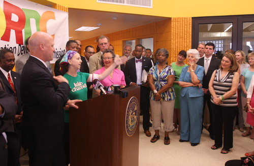 Irish Channel Neighborhood Association president Kara Morgan stands between Mayor Mitch Landrieu and former Council president Jackie Clarkson at the reopening of the Lyons Center in June 2013. (Robert Morris, UptownMessenger.com)
