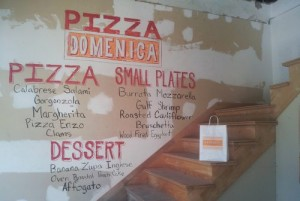 A sample menu for the planned Pizza Domenica chalked onto the wall of the building during August's open house. (Robert Morris, UptownMessenger.com)