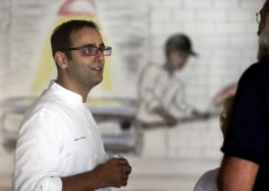 Dominica chef Alon Shaya chats with a neighbor of the proposed Magazine Street expansion at an open house in August. (UptownMessenger.com file photo by Robert Morris)