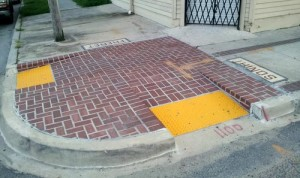 "The brick ""bumpout"" corners installed last year on Freret Street will be replaced starting Nov. 4, officials said. (UptownMessenger.com file photo by Robert Morris)"