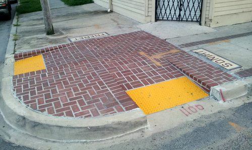 "The brick ""bumpout"" corners installed last year on Freret Street are all scheduled to be replaced this fall, officials said. (Robert Morris, UptownMessenger.com)"