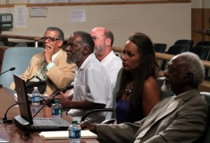 Lloyd Lazard, center, speaks to the City Council Economic Development committee. (Robert Morris, UptownMessenger.com)