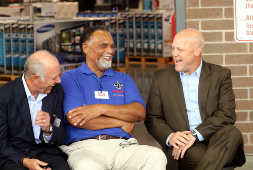 Costco cofounder Jeff Brotman (left), Costco New Orleans employee Henry Lagarde and Mayor Mitch Landrieu laugh together during the Costco grand opening ceremonies. (Robert Morris, UptownMessenger.com)