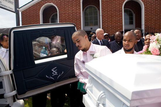 The casket  of 11-year-old Arabian Gayles is carried into the back of a hearse at the Prayer Tower Church of God in Christ on Willow St. Saturday. Gayles was shot multiple times, including in the head, after gunmen opened fire on a house in the 1300 block of General Ogden Street on Labor Day Weekend.  Two others were shot, but their injuries were not life threatening. (Sabree Hill, UptownMessenger.com)