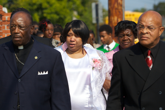Ashley Moffet, mother of Arabian Gayles, arrives at the Prayer Tower Church of God in Christ for her daughters funeral Saturday morning.  (Sabree Hill, UptownMessenger.com)