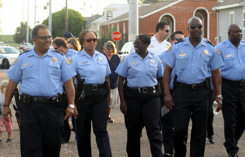 The NOPD Second District holds its monthly anti-crime march through west Carrollton on Wednesday evening. The Uptown-based district has one of the lowest numbers of officers in the city. (Sabree Hill, UptownMessenger.com)