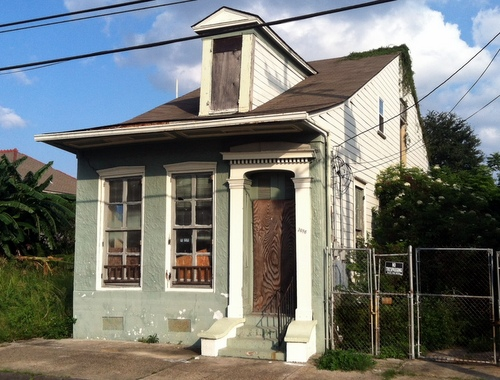 The house at 1016 North Roman in Treme had already been bid to 1 percent halfway through the first day of the three-day auction. (Photo by Jean-Paul Villere for UptownMessenger.com)