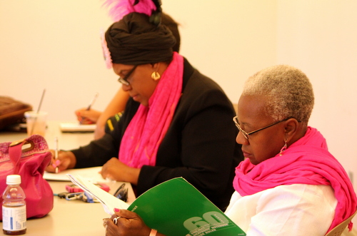 Cherice Harrison-Nelson and Blenda Robertson participate in the Poems and Pink Ribbons workshop. (photo courtesy of Kelly Harris)
