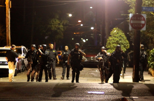 The NOPD SWAT Team marches onto Magazine Street after searching Pleasant Street for a robbery suspect. (Robert Morris, UptownMessenger.com)