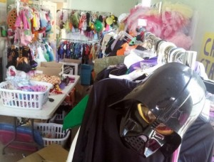 Racks of donated costumes fill the neighborhood center waiting to be handed out Tuesday. (Robert Morris, UptownMessenger.com)