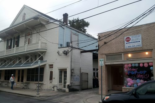 The owners of Oak wine bar plan to convert the former medical supply store into a gastropub called Ale, with a courtyard replacing the driveway next door. (Robert Morris, UptownMessenger.com)