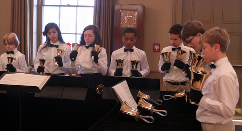 The St. Paul's Bell Choir performs in Poydras Home's renovated reception hall during the opening ceremonies. (Robert Morris, UptownMessenger.com)