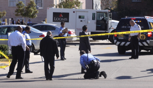 Police look for evidence at the scene. (Robert Morris, UptownMessenger.com)