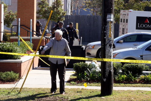 The coroner's investigator gives instructions at the scene. (Robert Morris, UptownMessenger.com)