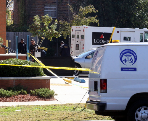 Police gather evidence at the crime scene. (Robert Morris, UptownMessenger.com)