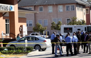 Investigators fill the parking lot of the Chase bank at Carrollton and Claiborne. (Robert Morris, UptownMessenger.com)