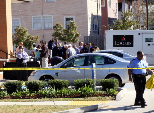Evidence is moved from the crime scene at the bank. (Robert Morris, UptownMessenger.com)