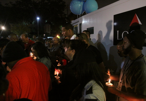 Supporters listen during a prayer at the vigil. (Robert Morris, UptownMessenger.com)