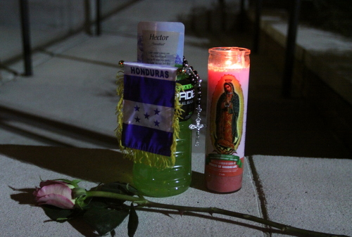 An impromptu memorial to Trochez sits on a ledge at the bank. (Robert Morris, UptownMessenger.com)