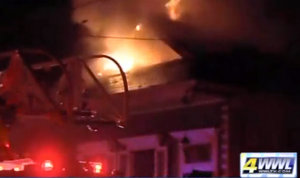 A house burns in a fire in the 2000 block of First Street. (photo via WWL-TV)