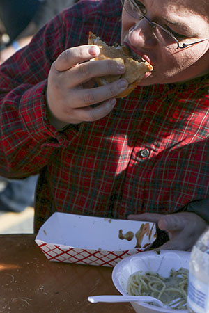 Ida Hancock enjoys a rockstar oyster poboy from Food from Seither's at the first annual Freret Street Oyster Jam.