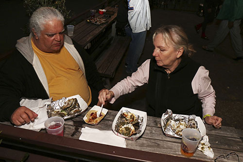 Ernest and Marlene Santalla celebrate their wedding anniversary with some oysters rockefeller at the Freret Street Oyster Jam. (Zach Brien, UptownMessenger.com)