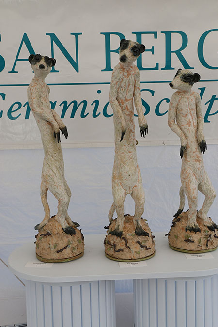 Louise, Eric and Petunia Meerkat by ceramic sculptor Susan E. Bergman