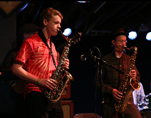 "Garland Bergeron (left) plays ""Little Liza Jane"" with the Little Big Horns' saxophonist Craig Flory (right)."