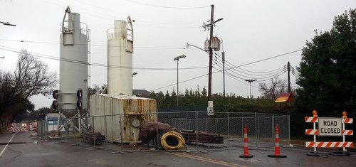 The silos blocking Jefferson Avenue near Constance will be moved in time for Mardi Gras parades, officials say. (Robert Morris, UptownMessenger.com)
