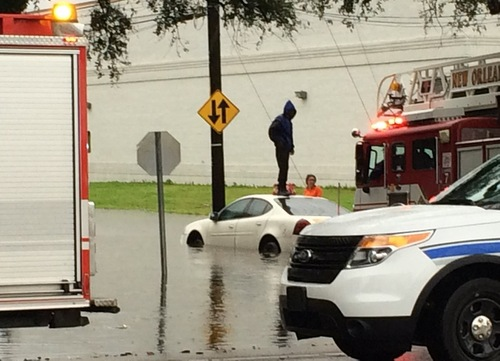 A car is stranded in deep water near Carrollton Avenue on Wednesday morning. (photo submitted by Drew Ward)