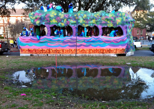 A float is reflected in the watery grave of a crepe myrtle. (photo by Jean-Paul Villere for UptownMessenger.com)