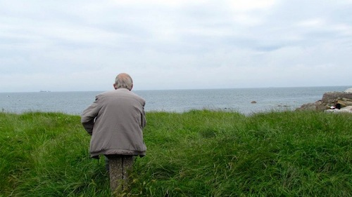 An Irish man looks over the Atlantic Ocean just south of Dublin  (via Jessica DeBold,   Uptown Messenger)