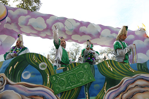 "Rider throws beads on Napoleon Ave. Pontchartrain's 2014  theme was ""What's Eating New Orleans."" (Zach Brien, UptownMessenger.com)"