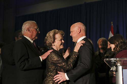 New Orleans mayor Mitch Landrieu (right) greets his father, former New Orleans mayor Moon Landrieu (left) and mother Verna.