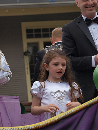 Young rider on the Queen of 2013's float. Krewe of Carrollton 2014. (Zach Brien, UptownMessenger.com)