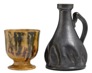 Pottery pieces will include this cup and candlestick by George Ohr and a Newcomb Pottery vase.